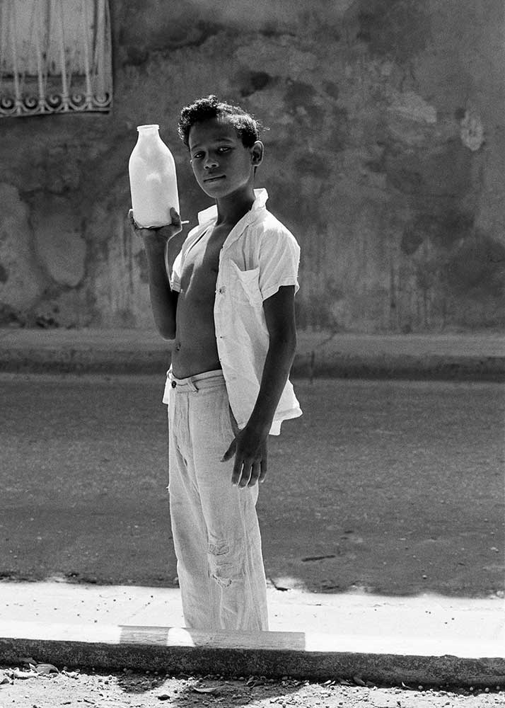 Boy with milk bottle, Santiago de Cuba